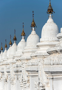 Row of stupas housing the world's largest book at Kuthodaw Pagoda in Mandalay, Burma (Myanmar)
