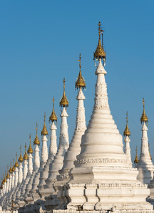 Row of white stupas at Sandamuni (Sanda Muni) Pagoda (Paya), Mandalay, Burma (Myanmar)