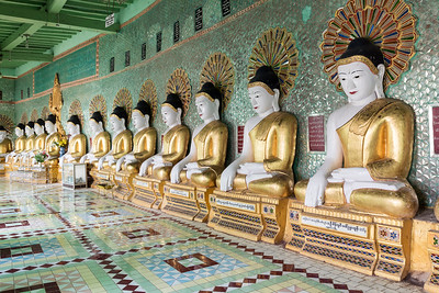 Row of statues of seated Buddhas in Umin Thounzeh (U Min Thonze) Pagoda on Sagaing Hill near Mandalay, Myanmar (Burma)