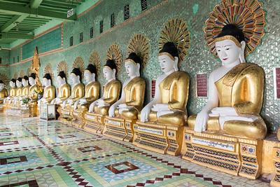 Row of statues of seated Buddhas in Umin Thounzeh (U Min Thonze) Pagoda on Sagaing Hill near Mandalay, Myanmar (Burma)