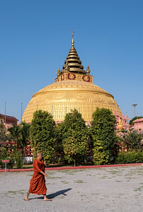 Monk in front of stupa at Sitagu International Buddhist Academy in Sagaing near Mandalay, Burma (Myanmar)