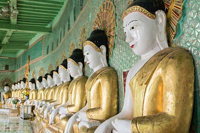 Buddha images inside Umin Thounzeh (U Min Thonze) Pagoda on Sagaing Hill near Mandalay, Myanmar (Burma)