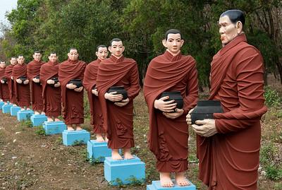 Row of statues of 500 Arahant followers of Buddha at Win Sein, Mudon near Mawlamyine, Mon State, Burma - Myanmar