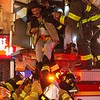 NEW YORK - January 23, 2020: for NEWS.  Firemen from Tower Ladder 1 and EMS rescue a man from a 3-alarm fire on Mulberry Street and Bayard Street in Chinatown. (Photo by: Taidgh Barron/NY Post)