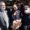 JACKSON HEIGHTS, QUEENS - March 14, 2021: for NEWS. Congressmember Alexandria Ocasio-Cortez, bringing flowers, meets with Queens business owners affected by a 4-Alarm conflagration on 74th Street in Jackson Heights that severely damaged five storefronts amid the COVID-19 Pandemic.  (Credit Photo by: Taidgh Barron)