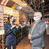 JACKSON HEIGHTS, QUEENS - March 14, 2021: for NEWS. Congressmember Alexandria Ocasio-Cortez tours the fire-damaged inside of Karishma, a women's clothes store for traditional Indian clothing, which was affected by a 4-Alarm conflagration on 74th Street in Jackson Heights in five storefronts amid the COVID-19 Pandemic. Not only did the store suffer damage from firefighters having to pull open the ceilings to reach the flames, the store's basement was also flooded with at least three feet of hose water. (Credit Photo by: Taidgh Barron)