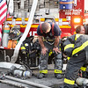STATEN ISLAND, N.Y. - June 26, 2021: for FIRE. FDNY firefighters work to extinguish a 2-Alarm house fire at 1072 Victory Blvd in Silver Lake. The box was transmitted as Richmond 0887.