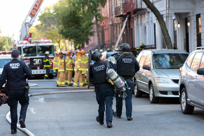 NEW YORK - October 18, 2019: for NEWS.  An NYPD ESU breach team approaching a building after a call of a man barricaded with a gun during a 2-alarm fire on W 131st Street in Harlem. (Photo by Taidgh Barron/NY POST)