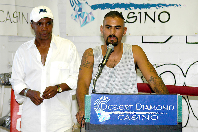 Tucson boxer, Nito Bravo, addresses the media with Sugar Ray Leonard looking on.