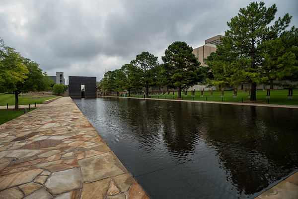 August 7, 2017:  A general view shows the reflecting pool and field of empty chairs at the Oklahoma City National Memorial, site of the April 19, 1995 bombing of the Alfred P. Murrah Federal Building in Oklahoma City, Oklahoma. The pool occupies what was once N.W. Fifth Street.