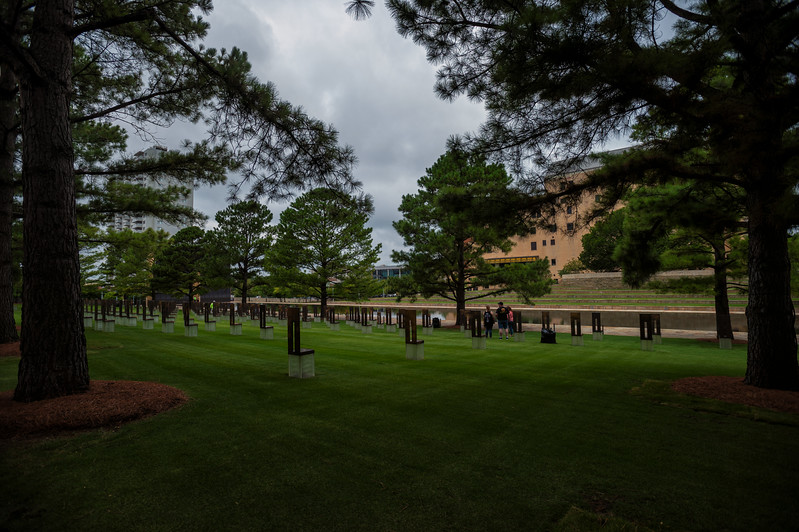 August 7, 2017:  Visitors roam the Field of Empty Chairs at the Oklahoma City National Memorial, site of the April 19, 1995 bombing of the Alfred P. Murrah Federal Building in Oklahoma City, Oklahoma. The Field of Empty Chairs sits on the footprint of the Alfred P. Murrah Federal Building and is a tribute to the 168 people who lost their lives in the bombing. The chairs stand in nine rows to represent each floor of the building and each chair bears the name of someone killed on that floor. Nineteen smaller chairs stand for the children who were killed.