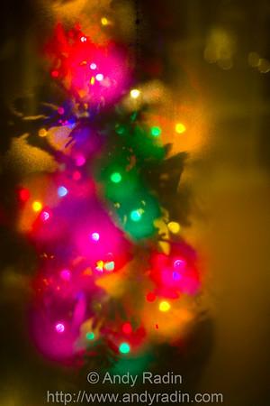 Christmas lights against a fogged-up shop window