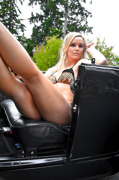 Bikini Model Sydney in a vintage car