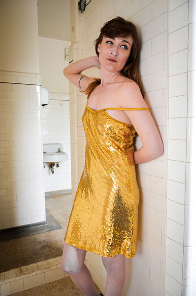 Model Melanie in a gold sequence dress - kinda cool - kinda hot - makes you smile - tried some new effects with this one.