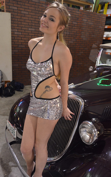 Anika Model in a very short skit and with a vintage car