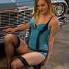 vintage classic lingerie model in front of a car
