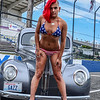 Bikini model skzul working a vintage car