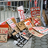 Protest signs created by the Democratic Socialists of America at Union Square during May Day demonstrations.
