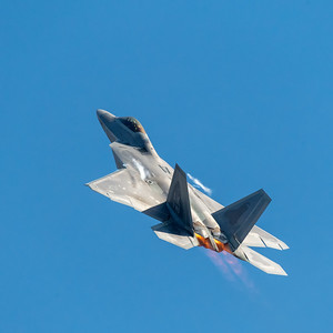 F-22 Raptor on afterburner heading skyward