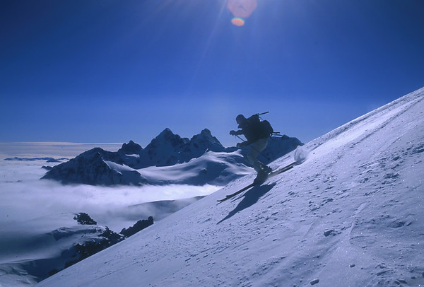 Skiing above the clouds in the Howson Range, British Columbia