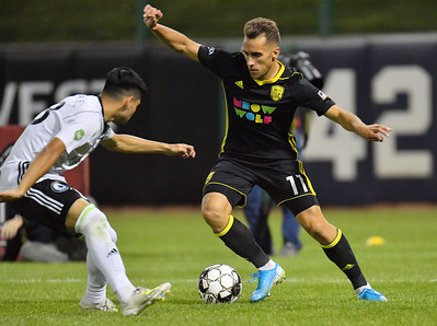 ALBUQUERQUE, NEW MEXICO - OCTOBER 16, 2019:  Santi Moar #11 of New Mexico United dribbles against Azriel Gonzalez #38 of Tacoma Defiance during the second half of their match at Isotopes Stadium on October 16, 2019 in Albuquerque, New Mexico. The Sounders and United tied 1-1.  (Photo by Sam Wasson)
