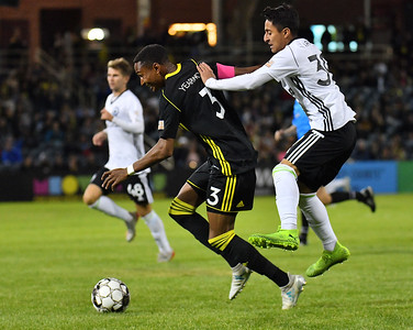 ALBUQUERQUE, NEW MEXICO - OCTOBER 16, 2019:  Austin Yearwood #3 of New Mexico United dribbles the ball past Marlon Vargas #39 of Tacoma Defiance during the second half of their match at Isotopes Stadium on October 16, 2019 in Albuquerque, New Mexico. The Sounders and United tied 1-1.  (Photo by Sam Wasson)