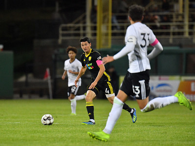ALBUQUERQUE, NEW MEXICO - OCTOBER 16, 2019:  Sam Hamilton #4 of New Mexico United looks to pass against Samuel Rogers #33 of Tacoma Defiance during the second half of their match at Isotopes Stadium on October 16, 2019 in Albuquerque, New Mexico. The Sounders and United tied 1-1.  (Photo by Sam Wasson)