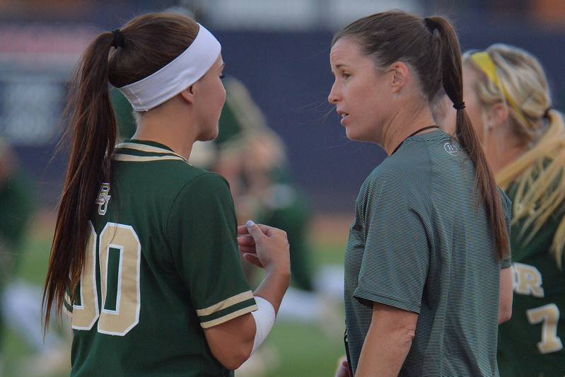 TUCSON, AZ - MAY 26:  Lindsey Cargill #90 of the Baylor Bears (L) talks to assistant coach Dani Price during game one of the NCAA Div. I Super Regional against the Arizona Wildcats on May 26, 2017 at Hillenbrand Stadium in Tucson, Arizona. Arizona won 3-2.  (Photo by: Sam Wasson)