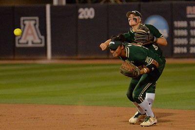 TUCSON, AZ - MAY 26:  Caitlin Charlton #5 of the Baylor Bears throws to first as Ari Hawkins #14 looks on during game one of the NCAA Div. I Super Regional against the Arizona Wildcats on May 26, 2017 at Hillenbrand Stadium in Tucson, Arizona. Arizona won 3-2.  (Photo by: Sam Wasson)