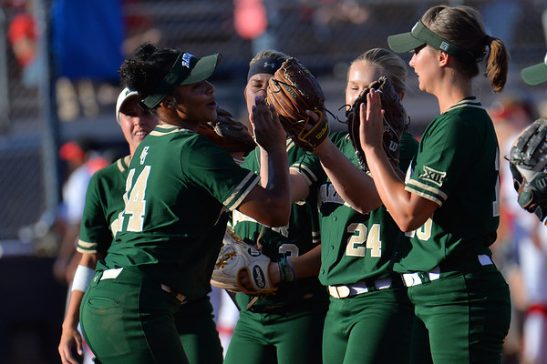 TUCSON, AZ - MAY 26:  Ari Hawkins #14 of the Baylor Bears high-fives her teammates before game one of the NCAA Div. I Super Regional against the Arizona Wildcats on May 26, 2017 at Hillenbrand Stadium in Tucson, Arizona. Arizona won 3-2.  (Photo by: Sam Wasson)