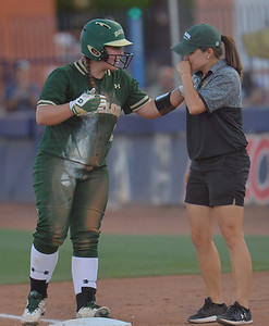 TUCSON, AZ - MAY 26:  Shelby Friudenberg #12 of the Baylor Bears talks to first base coach Britni Sneed Newman during game one of the NCAA Div. I Super Regional against the Arizona Wildcats on May 26, 2017 at Hillenbrand Stadium in Tucson, Arizona. Arizona won 3-2.  (Photo by: Sam Wasson)