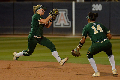 TUCSON, AZ - MAY 26:  Caitlin Charlton #5 of the Baylor Bears (L) snags a ground ball as Ari Hawkins #14 looks on during game one of the NCAA Div. I Super Regional against the Arizona Wildcats on May 26, 2017 at Hillenbrand Stadium in Tucson, Arizona. Arizona won 3-2.  (Photo by: Sam Wasson)