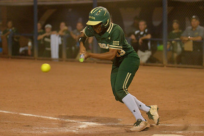 TUCSON, AZ - MAY 26:  Jessica Scroggins #15 of the Baylor Bears bunts during game one of the NCAA Div. I Super Regional against the Arizona Wildcats on May 26, 2017 at Hillenbrand Stadium in Tucson, Arizona. Arizona won 3-2.  (Photo by: Sam Wasson)