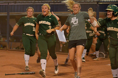 TUCSON, AZ - MAY 26:  The Baylor Bears dugout explodes after Ari Hawkins #14 of the Baylor Bears (not pictured) hit a home run during game one of the NCAA Div. I Super Regional against the Arizona Wildcats on May 26, 2017 at Hillenbrand Stadium in Tucson, Arizona. Arizona won 3-2.  (Photo by: Sam Wasson)