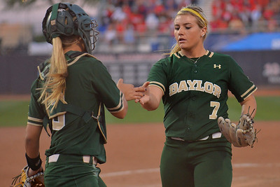 TUCSON, AZ - MAY 26:  Gia Rodoni #7 of the Baylor Bears (R) high fives Taylor Ellis #3 during game one of the NCAA Div. I Super Regional against the Arizona Wildcats on May 26, 2017 at Hillenbrand Stadium in Tucson, Arizona. Arizona won 3-2.  (Photo by: Sam Wasson)
