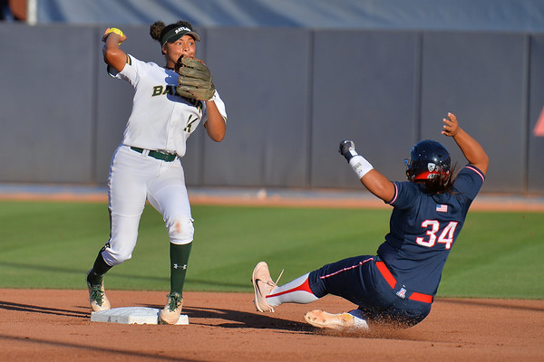 TUCSON, AZ - MAY 27:  Ari Hawkins #14 of the Baylor Bears (L) steps on second base while throwing to first base during game two of the NCAA Div. I Super Regional against the Arizona Wildcats on May 26, 2017 at Hillenbrand Stadium in Tucson, Arizona.  Baylor won 6-4.  (Photo by Sam Wasson)