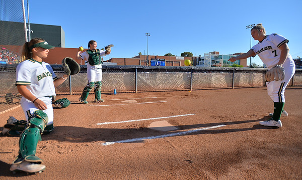 TUCSON, AZ - MAY 27:  Gia Rodoni #7 of the Baylor Bears (R) warms up before game two of the NCAA Div. I Super Regional against the Arizona Wildcats on May 26, 2017 at Hillenbrand Stadium in Tucson, Arizona.  Baylor won 6-4.  (Photo by Sam Wasson)
