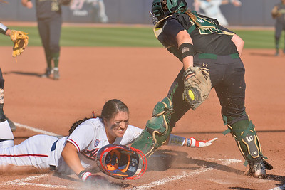 TUCSON, AZ - MAY 28:  Sydney Christensen (R) #20 of the Baylor Bears tags out Mo Mercado #11 of the Arizona Wildcats at the plate during game three of the NCAA Div. I Super Regional against the Arizona Wildcats on May 26, 2017 at Hillenbrand Stadium in Tucson, Arizona.  (Photo by Sam Wasson)