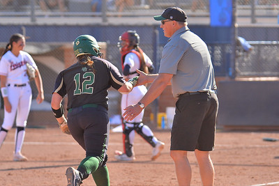 TUCSON, AZ - MAY 28:  Shelby Friudenberg (L) #12 of the Baylor Bears is congratulated after hitting a home run by head coach Glenn Moore during game three of the NCAA Div. I Super Regional against the Arizona Wildcats on May 26, 2017 at Hillenbrand Stadium in Tucson, Arizona.  (Photo by Sam Wasson)
