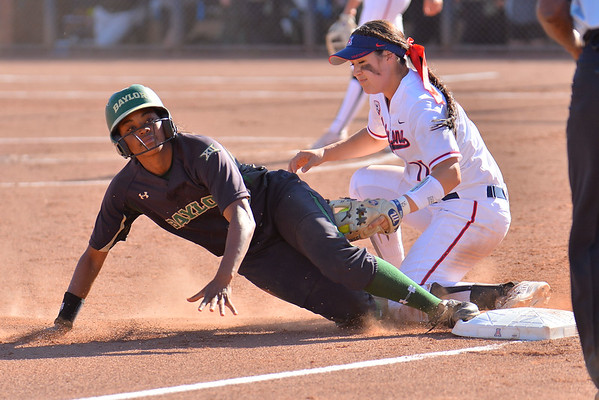 TUCSON, AZ - MAY 28:  Jessica Scroggins (L) #15 of the Baylor Bears slides into third base before the tag from Mo Mercado #11 of the Arizona Wildcats during game three of the NCAA Div. I Super Regional against the Arizona Wildcats on May 26, 2017 at Hillenbrand Stadium in Tucson, Arizona.  (Photo by Sam Wasson)
