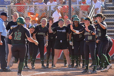 TUCSON, AZ - MAY 28:  Shelby Friudenberg (L) #12 of the Baylor Bears is congratulated by the Baylor Bears dugout after she hit a home run during game three of the NCAA Div. I Super Regional against the Arizona Wildcats on May 26, 2017 at Hillenbrand Stadium in Tucson, Arizona.  (Photo by Sam Wasson)