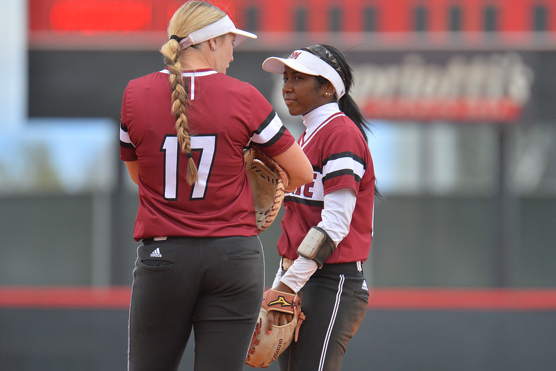 March 6, 2016: NM State first baseman Kelsey Horton (left) and second baseman Rachel Rodriguez (right) take a break between innings in a game between New Mexico State and No. 7 Oregon at the 2016 Alexis Park Resort Classic at Eller Media Stadium in Las Vegas, Nevada. The Aggies lost to the Ducks 8-0 via run rule.