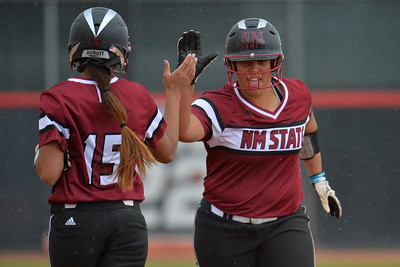 March 6, 2016: NM State designated player Corrin Green exchanges a high five with pinch runner Misty Hoohuli in a game between New Mexico State and No. 7 Oregon at the 2016 Alexis Park Resort Classic at Eller Media Stadium in Las Vegas, Nevada. The Aggies lost to the Ducks 8-0 via run rule.