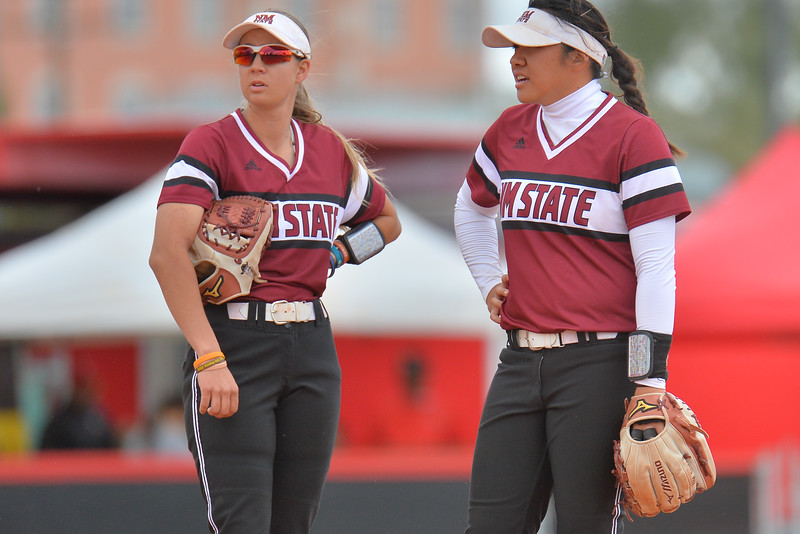 March 6, 2016: NM State third baseman Emma Adams (left) and shortstop Haley Nakamura (right) talk strategy during a break in the action in a game between New Mexico State and No. 7 Oregon at the 2016 Alexis Park Resort Classic at Eller Media Stadium in Las Vegas, Nevada. The Aggies lost to the Ducks 8-0 via run rule.