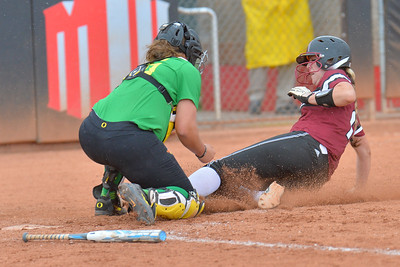 March 6, 2016: NM State first baseman Kelsey Horton is tagged out while sliding into home plate in a game between New Mexico State and No. 7 Oregon at the 2016 Alexis Park Resort Classic at Eller Media Stadium in Las Vegas, Nevada. The Aggies lost to the Ducks 8-0 via run rule.