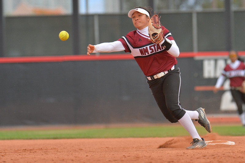 March 6, 2016: NM State shortstop Haley Nakamura throws a ball to first base in a game between New Mexico State and No. 7 Oregon at the 2016 Alexis Park Resort Classic at Eller Media Stadium in Las Vegas, Nevada. The Aggies lost to the Ducks 8-0 via run rule.