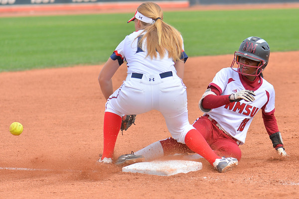 March 5, 2016: NM State second baseman Rachel Rodriguez slides safely into third base in a game between New Mexico State and Saint Mary's College at the 2016 Alexis Park Resort Classic at Eller Media Stadium in Las Vegas, Nevada. The Aggies defeated the Gaels via run rule 12-4.