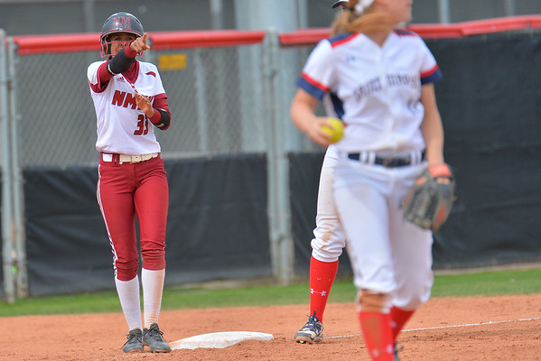 March 5, 2016: NM State pinch runner Lucy Mendoza congratulates her teammate on the base hit in a game between New Mexico State and Saint Mary's College at the 2016 Alexis Park Resort Classic at Eller Media Stadium in Las Vegas, Nevada. The Aggies defeated the Gaels via run rule 12-4.