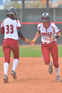 March 5, 2016: NM State third baseman Emma Adams and pinch runner Lucy Mendoza exchange a low five in a game between New Mexico State and Saint Mary's College at the 2016 Alexis Park Resort Classic at Eller Media Stadium in Las Vegas, Nevada. The Aggies defeated the Gaels via run rule 12-4.