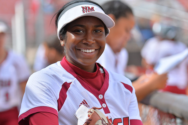 March 5, 2016: NM State second baseman Rachel Rodriguez smiles in the dugout in a game between New Mexico State and Saint Mary's College at the 2016 Alexis Park Resort Classic at Eller Media Stadium in Las Vegas, Nevada. The Aggies defeated the Gaels via run rule 12-4.
